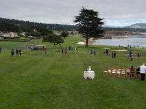 Pebble Beach with people enjoying the view Stock Image
