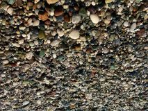 Pebble beach, the photo on the contrary, turned upside down. A different look, a lot of small colored stones, brown, white, green, moistened just gone wave royalty free stock photography