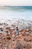 Pebble beach of Red Sea on sunset Royalty Free Stock Images