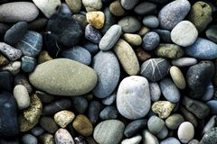 Pebble beach rocks royalty free stock photography
