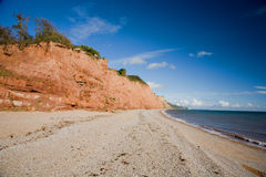 Pebble Beach and Sandstone Cliffs. The pebble beach and sandstone cliffs near Sidmouth in Devon, UK stock images