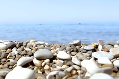 Pebble beach of the sea. Pebble beach and blue sky on background Royalty Free Stock Images