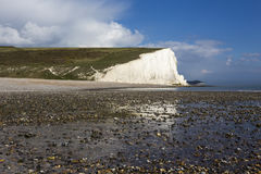 Pebble beach and the Seven Sisters Cliffs Royalty Free Stock Photos