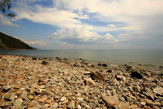 Pebble beach on the shore of lake Baikal. This place is on the Great Baikal Trail between the villages of Listvyanka and Bolshie Koty, where tourists are located Stock Images