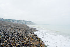 Pebble beach and shoreline at the Alabaster Coast. In Dieppe, France. Quiet melancholic day in October Royalty Free Stock Photography