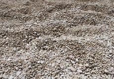 Pebble Beach stenar bakgrund Royaltyfria Bilder