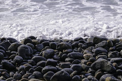 Pebble beach. Stones and water. Boil Royalty Free Stock Images