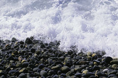 Pebble beach. Stones and water Royalty Free Stock Images