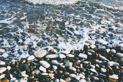 Pebble beach and waves. Royalty Free Stock Photos