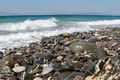 Pebble beaches of the Aegean Sea on the island of Kos. In Greece royalty free stock image