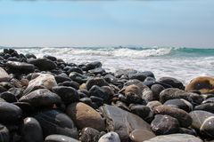 Pebble beaches of the Aegean Sea on the island of Kos. In Greece stock images
