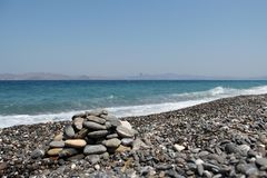 Pebble beaches of the Aegean Sea on the island of Kos. In Greece royalty free stock photography
