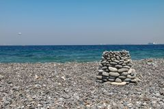 Pebble beaches of the Aegean Sea on the island of Kos. In Greece royalty free stock photo