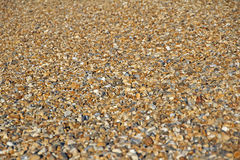 Pebble- Beachhintergrund Stockbilder