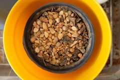 Pebble. In the black and yellow pots, Top view Stock Photo