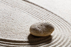 Pebble for concept of suppleness or flexibility with care. Zen sand still-life - one pebble for concept of suppleness or flexibility with care and smoothness Royalty Free Stock Images