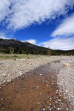 Pebble Creek under cumulus cirrus cloudscape at the east end of the Lamar Valley in Yellowstone National Park in Wyoming USA Royalty Free Stock Images