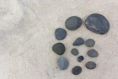 Pebble Design on Sand Royalty Free Stock Photo