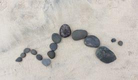 Pebble Design on Sand 2 Royalty Free Stock Photos