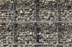 Pebble fence Stock Images