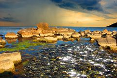 Pebble, Glare, Shallow Water Royalty Free Stock Photos
