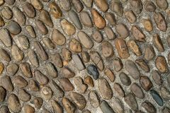 Pebble or gravel stone texture floor background. Old rough random pebble or gravel stone texture floor background.have some space for write wording stock photography