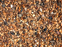 Pebble ground pattern, gravel floor material, soil surface. Pebble ground pattern, orange gravel floor material, brown soil surface, natural garden land backdrop royalty free stock photos
