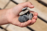 Pebble in the hand Royalty Free Stock Images