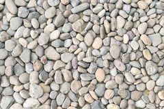 Pebble heap as abstract natural background. Royalty Free Stock Photography