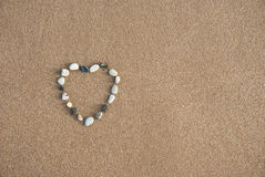 Pebble Heart on the beach. A heart made out of pebbles on a beach Royalty Free Stock Photos