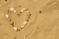Pebble Heart in the Sand Royalty Free Stock Photography
