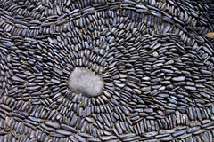 Pebble mosaic pavement closeup for background Royalty Free Stock Image