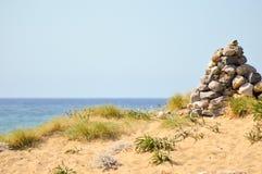 Pebble mound on a sand dune stock image
