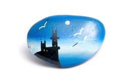 A pebble with a painting. A souvenir pebble with a painting of old fortress Royalty Free Stock Images