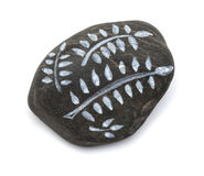 Pebble painting - lava pebble with floral design Stock Photography