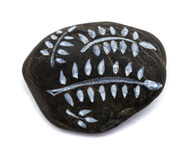 Pebble painting - lava pebble with floral design Royalty Free Stock Image