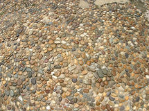 Pebble Path. A sidewalk made of small multicolored pebbles royalty free stock photos