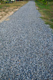 Pebble pattern in road Stock Photography