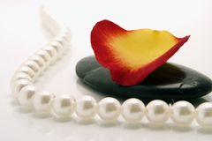 Pebble and pearls Stock Photos