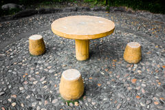 Pebble road Stone bench and Stone table Stock Photos