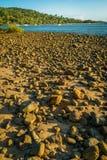 Pebble rocks on the beach in 1770 in Australia stock image