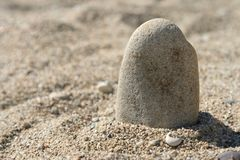 Pebble and sand Royalty Free Stock Photo