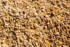 Pebble sand background. Yellow texture Stock Photography