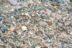 Pebble at the sand Stock Photography
