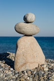 Pebble sculpture at the beach Stock Photography