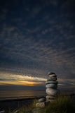 Pebble sculpture on a beach. Stock Photos
