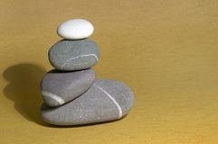 Pebble Sculpture on sand Royalty Free Stock Images