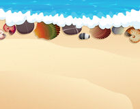 Pebble and seashells on the sand Stock Image