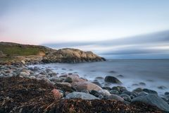 Pebble shore at Hove, Tromoy in Arendal, Norway. Raet National Park. Long exposure. Pebble shore at Hove, Tromoy in Arendal, Norway. Picture shows a part of Stock Photography