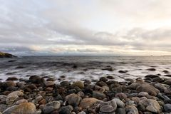 Pebble shore at Hove, Tromoy in Arendal, Norway. Raet National Park. Long exposure. Pebble shore at Hove, Tromoy in Arendal, Norway. Picture shows a part of Royalty Free Stock Photo